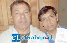 Miguel Torres presidente, junto a Juan Vega, comerciante feria de las pulgas.